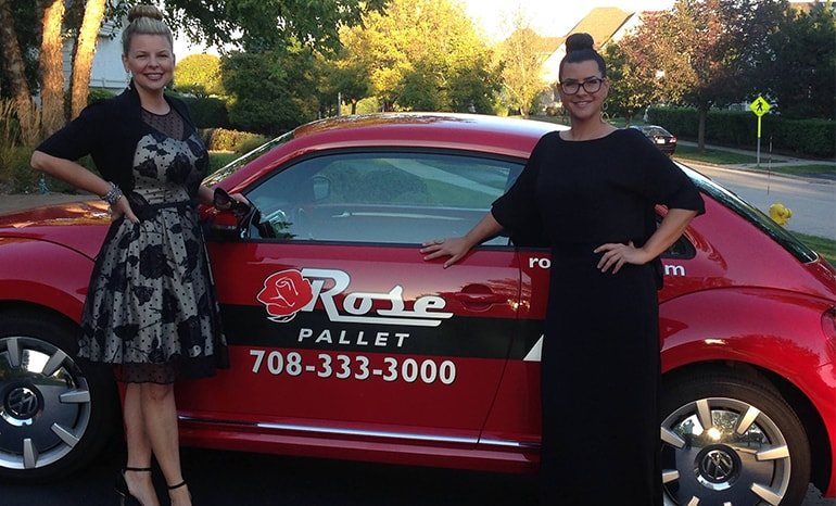 amy olson and mia allen in front of rose pallet car