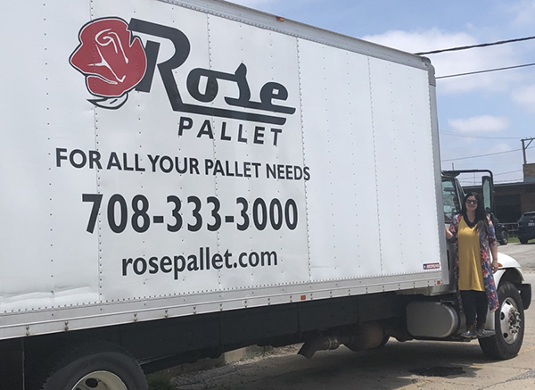 side view of semi truck with rose pallet branding