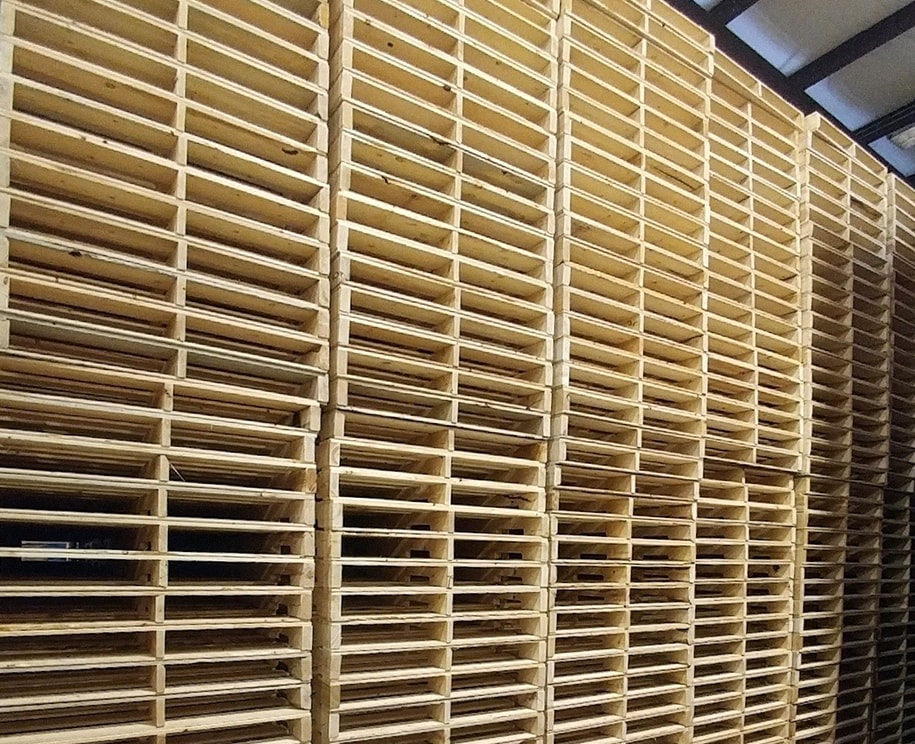 new pallets stacked to the ceiling in rose pallet warehouse
