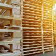 warehouse full of stacked pallets