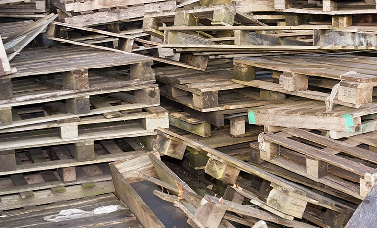 old broken pallets in a pile