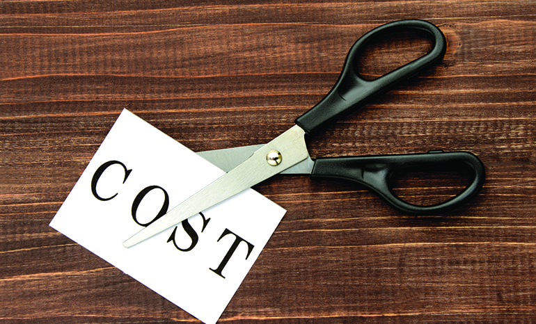"""scissors cutting a paper that says """"cost"""""""