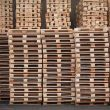 hundreds of wooden pallets stacked up