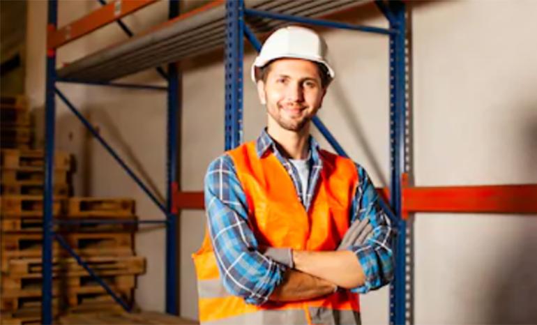 gentleman smiling in pallet warehouse