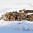 wooden pallets covered in snow