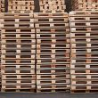 multiple wooden pallets piled up